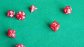 baize : player throws two dies of red dungeons & dragons board game on green baize gaming table close up