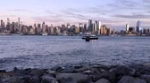 terrorist : NEW YORK CITY, USA - October 9, 2016: New York Uptown at dusk, with a Census-estimated population of over 8.4 million in 2013 is the most populous city in the United States Stock Footage