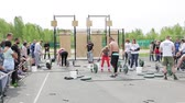 weightlifting : Confident teams of young weightlifters compete in lifting the bar and other exercises