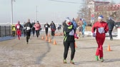 maraton : Winter athletes run through the snowy street of the Siberian city