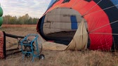 Preparations of hot air balloon before flight Stock Footage