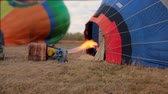 Air balloon being inflated with propane gas burner before flight