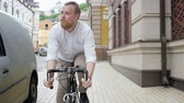 acımasız : Slow motion video of stylish man with beard riding vintage bicycle Stok Video