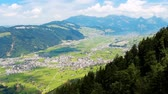 svájci : Aerial footage of beatiful high mountains covered with trees at sunny day in Switzerland Alps