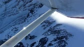 appalachian : View from inside of small airplane on the snow covered mountain peaks