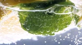 tonic : Closeup slow motion video of bubbles floating in glass of cold lemonade