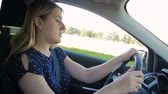 безопасный : Slow motion footage of young woman feeling very tired and falls asleep while driving car