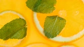 limonata : Macro footage from top view of fresh lemonade with mint and oranges Stok Video