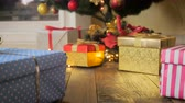 gold coloured : Closeup 4k footage of camera flying between gifts under Christmas tree