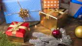 christmas tree ornament : Closeup 4k footage of camera slowly panning over Christmas gifts and baubles lying on floor Stock Footage