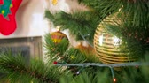 bombki : Closeup 4k video of camera moving through branches of decroated Christmas tree Wideo