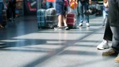 4k out of focus video of passengers feet and suitcases on floor at international airport terminal