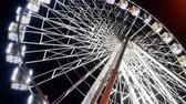 4k video of big ferris wheel at night