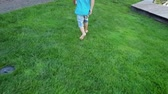 bambini : 4k footage of barefoot toddler boy running on fresh green grass at park