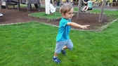 bambini : 4k video of smiling toddler boy running at beautiful summer park