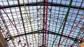 strop : 4k footage of beautiful glass roof at shopping mall decorated with colorful ribbons for holidays