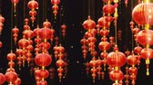 Chinese new year red paper latern decoration moving in space with falling gold particles. Chinese new year festive background. Loop 4K animation. Wideo