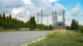 szelep : time lapse of petrochemical and chemical plant industrial, cloud movement, with road and public car and truck transportation road to chemical plant to delivery of fuel, raw material, and equipment for business Stock mozgókép