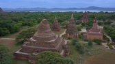 işe : Aerial view of Old Bagan Archaeological Park with ancient temples, pagodas and stupas around Mee Nyein Gone Phaya Temple, Old Bagan, Burma (Myanmar) Stok Video