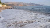 dahab : The sea wave is crashing on the sand beach, in Egypt Stock Footage