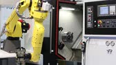 orsó : Moscow, Russia - May, 2018: Fanuc M-20iA robot hand with Schunk gripper operating with CNC machine Stock mozgókép