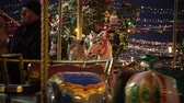 red square : Moscow, Russia - December, 2017: Carousel with rocking horses on christmas market in Moscow, Russia Stock Footage