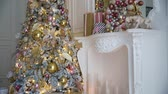 камин : White room interior with New Year tree decorated, present boxes and fireplace
