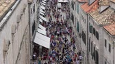 hırvat : Dubrovnik, Croatia - June, 2018: Crowd of torists on main street of Dubrovnik city in Croatia Stok Video