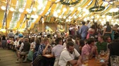 munique : Munich, Germany - September, 2018: Crowd of people in Paulaner tent in Munich city, Germany Vídeos