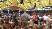 sarhoş : Munich, Germany - September, 2018: Crowd of people in Paulaner tent in Munich city, Germany Stok Video