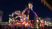 sarhoş : Munich, Germany - September, 2018: Night attractions on Oktoberfest at night in Munich city, Germany