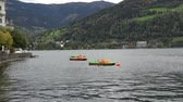 austrian : Zell am See, Austria - October, 2018: Small paddleboats on the lake of Zell am See, Austria
