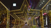 Moscow, Russia - December, 2017: Light star glowing tunnel on the street of Moscow, New Year and christmas decoration of the city
