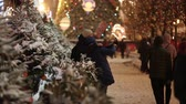 red square : Moscow, Russia - December, 2017: Snowing on christmas market fair in Moscow, Russia Stock Footage
