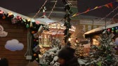Moscow, Russia - December, 2017: Snowing on christmas market fair in Moscow, Russia Vídeos