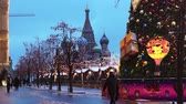 Moscow, Russia - January, 2018: New Year tree on Red square, snowing on christmas market fair Wideo