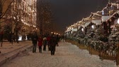 red square : Moscow, Russia - January, 2018: Snowing on christmas market fair in Moscow, Russia