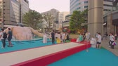 空手 : Tokyo, Japan - August 25,2019: Event for the Olympic Games in Tokyo 2020. Passers-by could test Long jump fountain to rediscover the limits exceeded by athletes. This fountain has the same distance as 動画素材