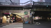 ziegel : Tokyo, Japan - August 25, 2019: Concourse Yuraku under the Yurakucho station. There are noodle stalls and sake bars with old posters glued to the walls of tunnel.