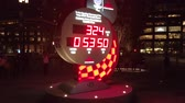 videospiel : Tokyo, Japan - October 06 2019: Video of the Official olympic timekeeper Omega countdown clock for the Olympic and Paralympic Games Tokyo 2020 in front of the Tokyo Station at night.