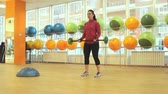 heavy : Young woman doing exercise with barbell Stock Footage