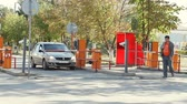 entrada da garagem : Volgograd, Russian Federation - September 27, 2015: Automatic security barrier at parking in International Airport Volgograd.