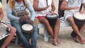 bicí : Goa, India – February 28, 2015: Unidentified man playing on drum at the beach.