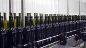 blockage : Bottling and sealing conveyor line at winery factory Stock Footage