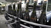 blockage : Sennoy, Russian Federation – February 15, 2018: Bottling and sealing conveyor line at winery factory Stock Footage