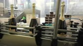 cinta transportadora : Sennoy, Russian Federation – February 15, 2018: Bottling and sealing conveyor line at winery factory