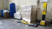 shrink : Sennoy, Russian Federation – February 14, 2018: Packing of boxes with wine on a pallet in the polymeric film