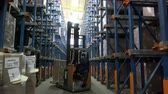 stacking : Sennoy, Russian Federation – February 14, 2018: Work of loaders on loading pallets with cardboard boxes on racks in a modern warehouse