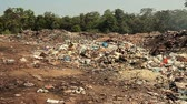 aterro : Large garbage dump waste with smoke at sunny day