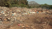 likvidace : Large garbage dump waste with smoke at sunny day